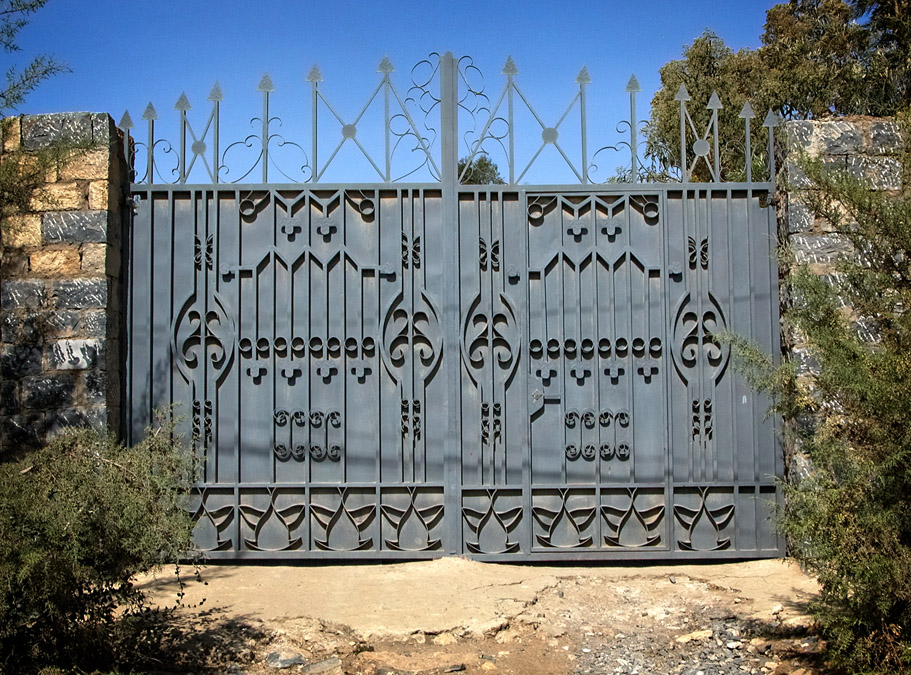 Gates of Mekelle #18 is a dark grey gate with a unique bird-like detail