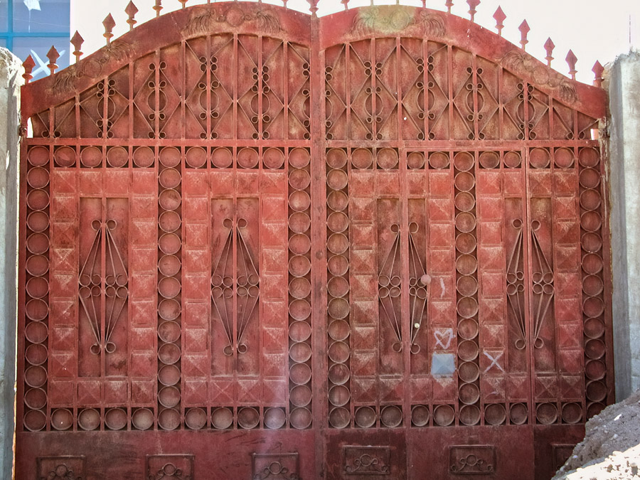 Gates of Mekelle #16 is a red gate with spear tips and scroll details