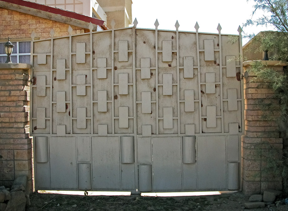 Gates of Mekelle #15 light grey gate with geometric pattern