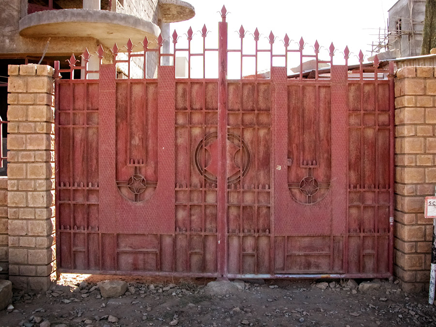 Gates of Mekelle #14 a dark red colour with spear tipped top and stars